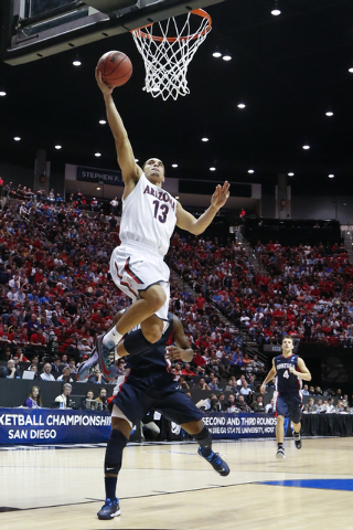 Arizona guard Nick Johnson, above, shoots above Gonzaga guard Gary Bell, Jr. during the first half of a third-round game in the NCAA college basketball tournament Sunday, March 23, 2014, in San Di ...