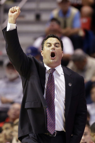 Arizona head coach Sean Miller gestures to his team as they play Gonzaga during the first half of a third-round game in the NCAA college basketball tournament Sunday, March 23, 2014, in San Diego. ...