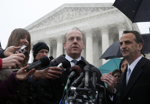 Paul Clement, attorney for Hobby Lobby and Conestoga Wood, center, stands with attorney David Cortman, right, as they speak to reporters in front of the Supreme Court in Washington, Tuesday, March ...