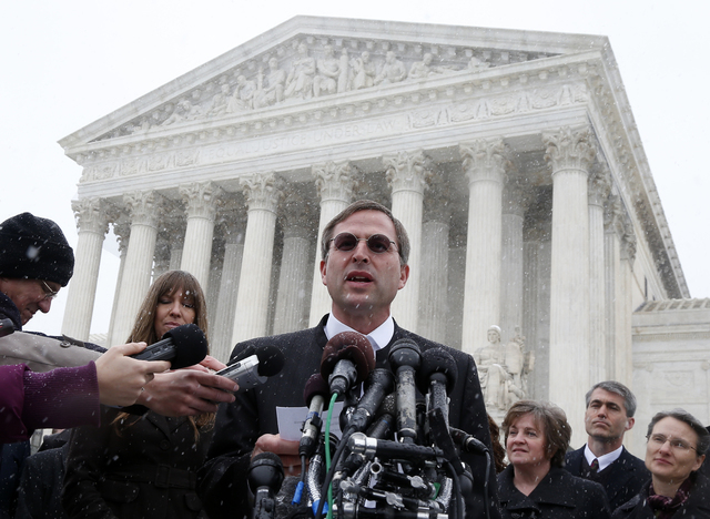 Anthony Hahn, chief executive officer of Conestoga Wood Specialties, speaks to reporters in front of the Supreme Court in Washington, Tuesday, March 25, 2014, after the court heard oral arguments  ...