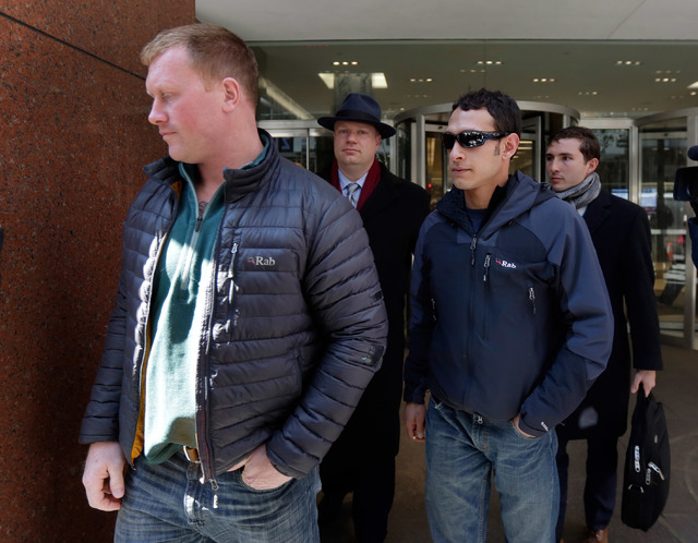 James Brady, and Andrew Rossig, foreground left and right, two parachutists who jumped from One World Trader Center in September 2013, are accompanied by attorneys Timothy Parlatore, background le ...