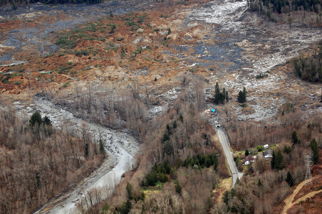 This March 22, 2014 photo, made available by the Washington State Dept of Transportation shows a view of the damage from Saturday's mudslide in Oso, Wash. At least eight people were killed in the  ...