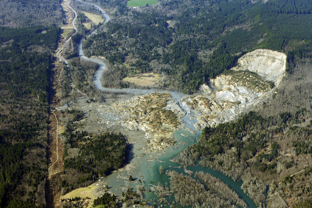 This aerial photo taken Monday, March 24, 2014 shows the massive mudslide that killed at least eight people Saturday and left dozens missing, near Arlington, Wash. The search for survivors grew Mo ...