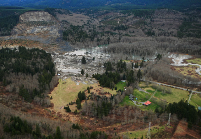 This March 23, 2014 photo, made available by the Washington State Dept of Transportation shows a view of the damage from Saturday's mudslide near Oso, Wash. At least eight people were killed in th ...