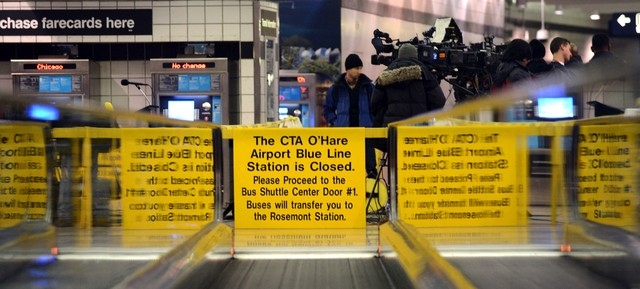 Signs alert travelers to the closing of the Blue Line train station Tuesday, March 25, 2015, at O'Hare International Airport in Chicago after Monday's crash of a commuter train. National Transport ...