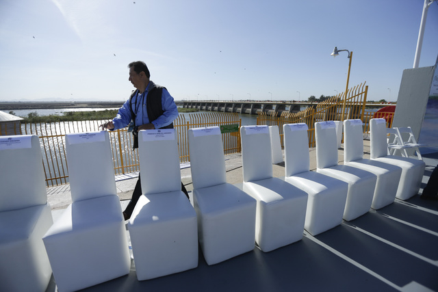A Mexican official counts the chairs for visiting dignitaries shortly before a ceremony to mark the climax of a Colorado River water pulse event Thursday, March 27, 2014, Los Algodones, Mexico. Co ...