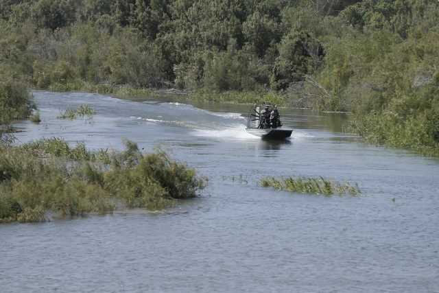A US Border Patrol boat moves up the Colorado River during a ceremony Thursday, March 27, 2014, Los Algodones, Mexico.Colorado River water has begun pouring over a barren delta near the U.S.-Mexic ...
