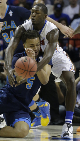UCLA guard/forward Kyle Anderson (5) works against Florida forward Dorian Finney-Smith (10) during the first half in a regional semifinal game at the NCAA college basketball tournament, Thursday,  ...