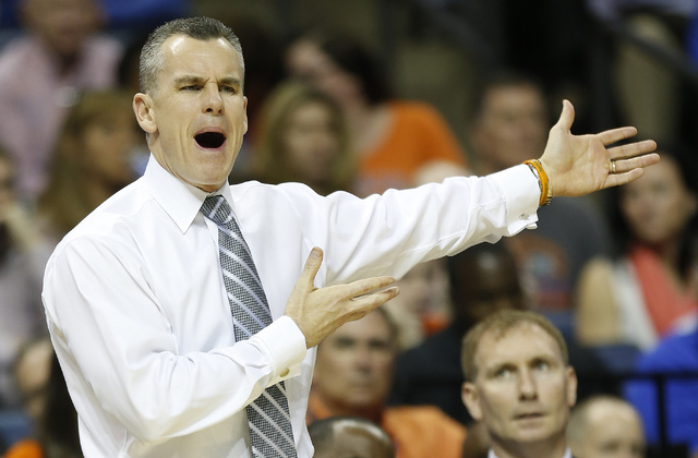 Florida head coach Billy Donovan, speaks to his players against UCLA during the first half in a regional semifinal game at the NCAA college basketball tournament, Thursday, March 27, 2014, in Memp ...
