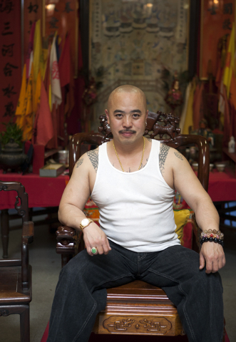 """In this image provided by Jen Siska, Raymond """"Shrimp Boy"""" Chow, is seen posing for a portrait in San Francisco in July 2007.  Investigators say Chow is the leader of one of the most powerful Asian ..."""