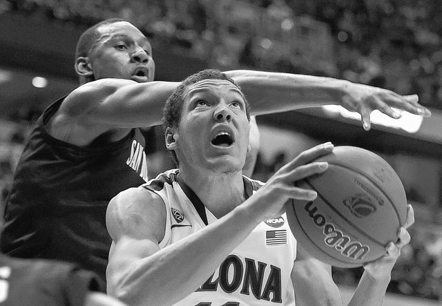 San Diego State guard Xavier Thames, left, defends as Arizona forward Aaron Gordon drives during the first half of an NCAA men's college basketball tournament regional semifinal, Thursday, March 2 ...