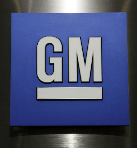 FILE - In this Jan. 25, 2010, file photo, a General Motors Co. logo is shown during a news conference in Detroit. General Motors is boosting by 971,000 the number of small cars being recalled worl ...