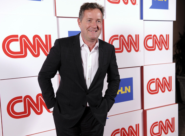 """FILE - This Jan. 10, 2014 file photo shows Piers Morgan of the CNN show """"Piers Morgan Live"""" at the CNN Worldwide All-Star Party, in Pasadena, Calif. (Photo by Chris Pizzello/Invision/AP, ..."""