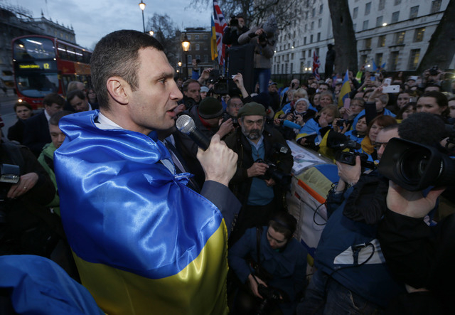 Ukraine's MP Vitali Klitschko, leader of the UDAR (Ukrainian Democratic Alliance for Reform) party addresses protesters outside 10 Downing Street in London after a meeting with British Prime Minis ...