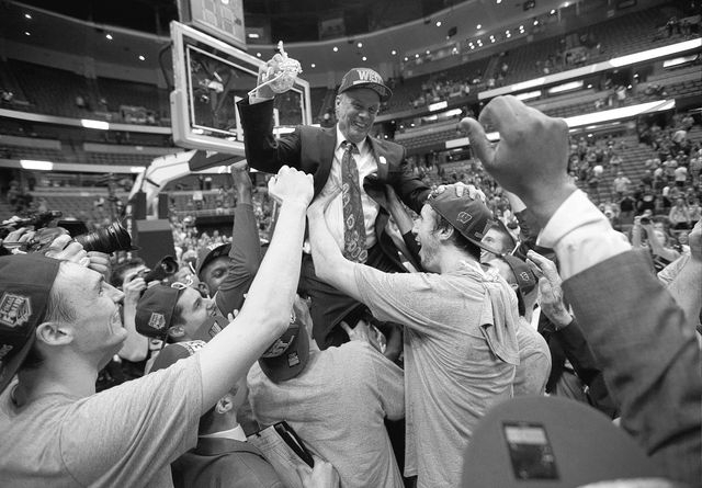 Players lift Wisconsin head coach Bo Ryan after a regional final NCAA college basketball tournament game against Arizona, Saturday, March 29, 2014, in Anaheim, Calif. Wisconsin won 64-63 in overti ...