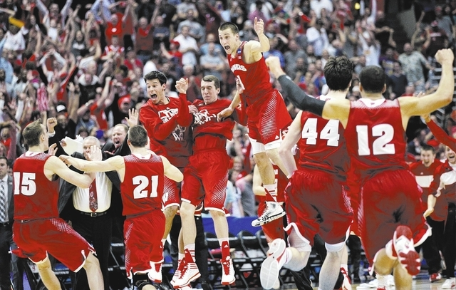 Wisconsin players react as time runs out in overtime of a regional final NCAA college basketball tournament game, Saturday, March 29, 2014, in Anaheim, Calif. Wisconsin won 64-63 in overtime. (AP  ...