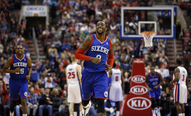 Philadelphia 76ers' Tony Wroten smiles after a basket during the second half of an NBA basketball game against the Detroit Pistons, Saturday, March 29, 2014, in Philadelphia. Philadelphia won 123- ...
