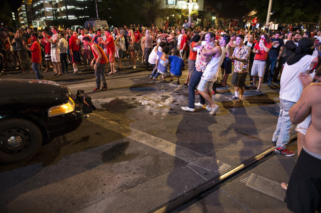 Students clashed against Tucson Police officers on University Avenue Saturday March 29, 2014 in Tucson, Ariz. after Arizona's loss to Wisconsin 64-63 in the West Region NCAA final. Projectiles wer ...