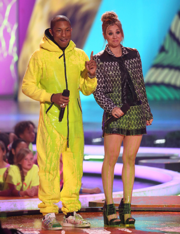 Pharrell Williams, left, and Kaley Cuoco present the award for favorite female singer at the 27th annual Kids' Choice Awards at the Galen Center on Saturday, March 29, 2014, in Los Angeles. (Photo ...
