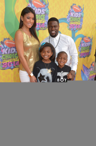From left, Torrei Hart, Kevin Hart, Heaven Hart and Hendrix Hart arrive at the 27th annual Kids' Choice Awards at the Galen Center on Saturday, March 29, 2014, in Los Angeles. (Photo by John Shear ...