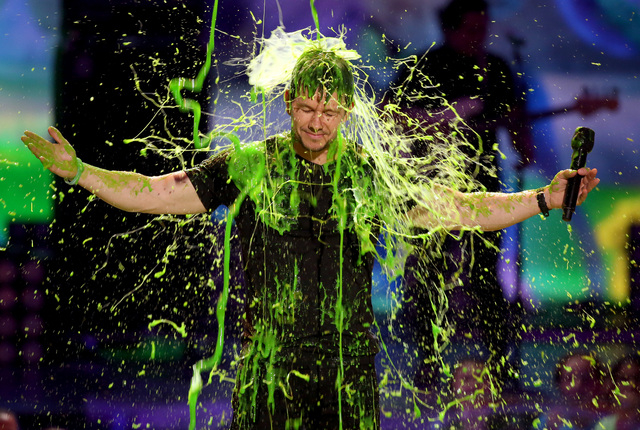 Mark Wahlberg gets slimed at the 27th annual Kids' Choice Awards at the Galen Center on Saturday, March 29, 2014, in Los Angeles. (Photo by Matt Sayles/Invision/AP)