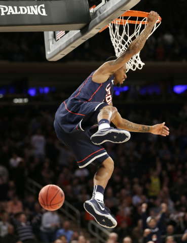Connecticut's Ryan Boatright dunks the ball in the first half of a regional final against  Michigan State at the NCAA college basketball tournament on Sunday, March 30, 2014, in New York. (AP Phot ...