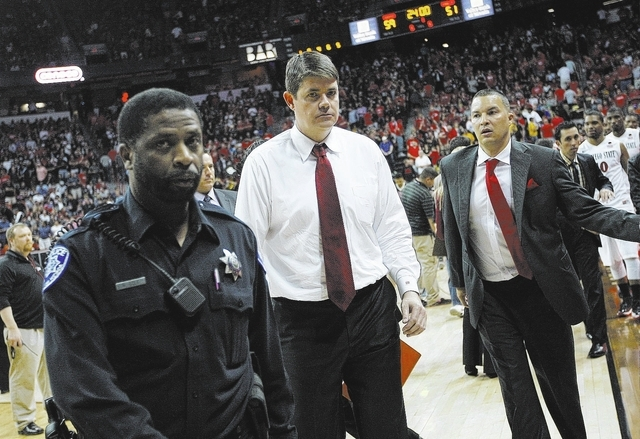 UNLV head coach Dave Rice heads off the court after his team lost to San Diego State 59-51 during their Mountain West basketball tournament semi-final game at the Thomas & Mack Center in Las Vegas ...