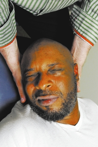 Brian Snoddy, a resident of Nevada's 1st Congressional District since 2011, gets treatment on his neck from his therapist Joseph Indrieri at Dynamic Spine & Sport Rehabilitation in Las Vegas on Ma ...