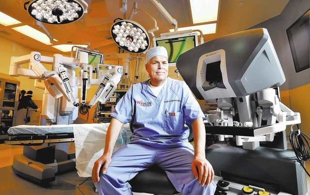 Dr. Darin Swainston is shown at the console of the da Vinci robotic system he uses for hysterectomies at the Summerlin Hospital Medical Center at 657 N. Town Center Drive in Las Vegas on Thursday, ...