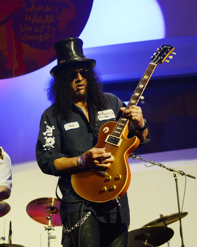 "Slash performs during the Kerry Simon ""Simon Says Fight MSA"" benefit concert at The Keep Memory Alive Center in Las Vegas on February 27, 2014 in Las Vegas, Nevada."