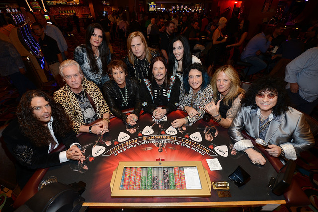 Michael T. Ross, Howard Leese, Carol-Lyn Liddle, Jay Schellen, Andrew Freeman, John Payne, Stephanie Calvert, Robin McAuley, Doug Aldrich and Paul Shortino pose for a photo at the LVH. (Photo by D ...