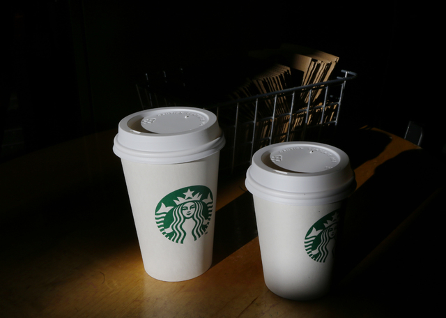 Starbucks is adding a digital tipping option to its mobile payment app. (AP Photo/Ted S. Warren, File)