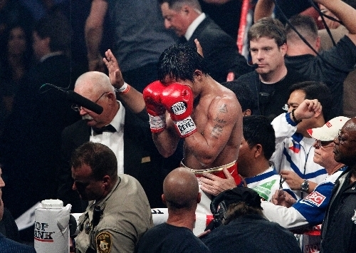 Manny Pacquiao leaves the ring after losing a controversial split decision to Timothy Bradley in June 2012. The two boxers will meet again on April 12 at the MGM Grand Garden. (John Locher/Review- ...