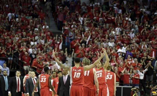 New Mexico's Kendall Williams (10) raises his hands to the crowd during the second half of an NCAA college basketball game against San Diego State for the Mountain West Conference tournament champ ...