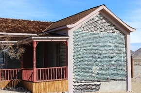 The three-room Tom Kelly Bottle House in Rhyolite was erected in 1906. He used about 50,000 old beer and liquor bottles for the main construction. (Las Vegas Review-Journal file photo)