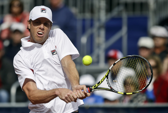 Sam Querrey returns a shot against Britain's James Ward during a Davis Cup tennis match Friday, Jan. 31, 2014, in San Diego. Querrey was going to be the marquee player for the Las Vegas Neon, but  ...
