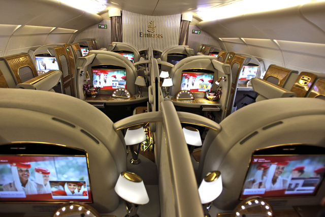 FILE - In this Sunday, Feb. 10, 2013, file  photo the first class section of an Emirates airlines Airbus A380 is ready for boarding at the new Concourse A of Dubai airport in Dubai. When Emirates  ...