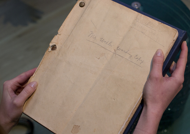 The front cover of the then originally titled 'American' or as it is now known 'Citizen Kane' film which was Orson Well working copy of the script held by an employee of Sotheby's auction house in ...
