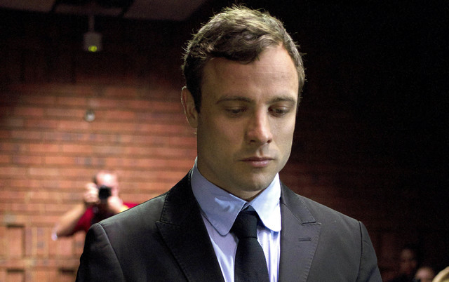In this Monday, Aug. 19, 2013 file photo, double-amputee Olympian Oscar Pistorius appears at the magistrates court to be indicted on charges of murder and illegal possession of ammunition for the  ...