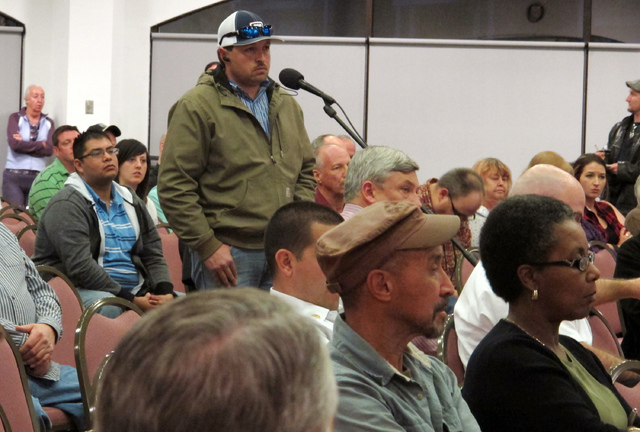 A member of the community speaks of the Feb. 14, 2014 radiation leak during a community meeting  in Carlsbad, N.M.  New Mexico Sen. Tom Udall says he will ask the Environmental Protection Agency t ...