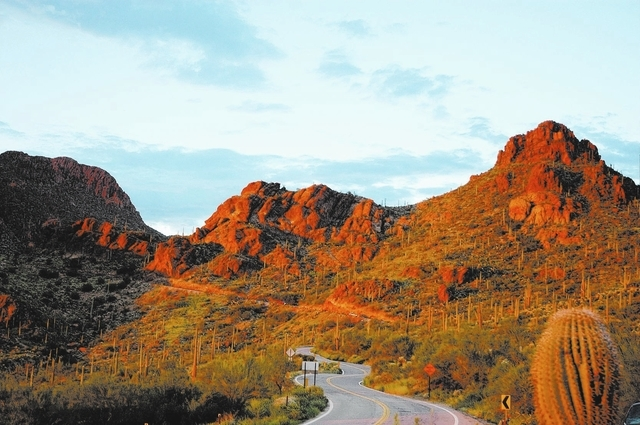 This undated image released by Visit Tucson shows Gates Pass in the Tucson Mountains, west of Tucson, Ariz.  Its a popular gathering place at sunset thanks to its scenic beauty, one of a number of ...