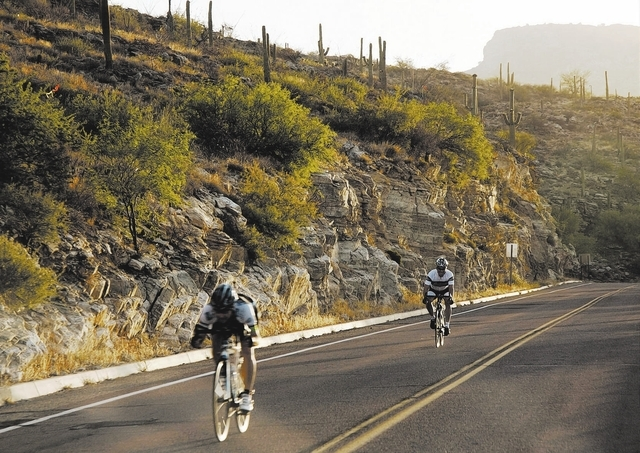 This undated image released by Visit Tucson shows bicyclers riding down Mt. Lemmon highway in Tucson, Ariz.  Its a popular gathering place at sunset thanks to its scenic beauty, one of a number of ...