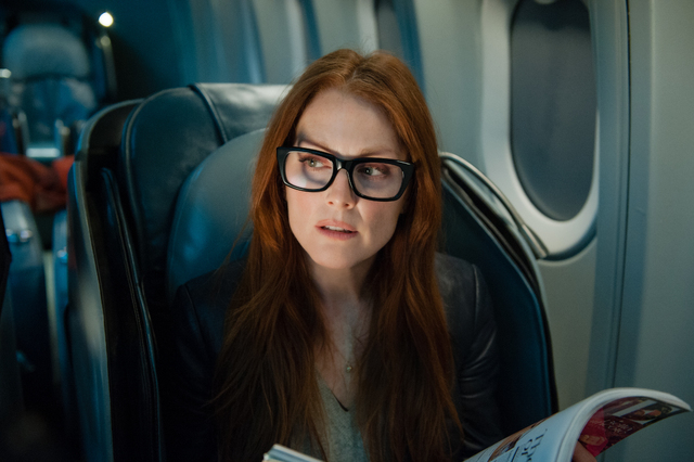 """This image released by Universal Pictures shows Julianne Moore in a scene from """"Non-Stop."""" (AP Photo/Universal Pictures, Myles Aronowitz)"""