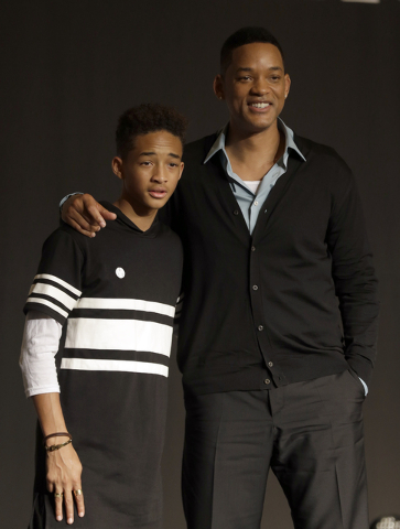 """U.S. actor Will Smith and his son Jaden pose for the media after press conference for their film """"After Earth"""" in Seoul, South Korea. Both actors were awarded Razzies for the film. Jaden was selec ..."""