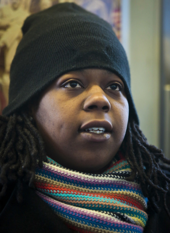 Naquasia LeGrand sits on a subway, leaving her home in the Carnarsie section of Brooklyn to her KFC job in Manhattan, on Thursday Feb. 27, 2014 in New York.  A few months ago, LeGrand was just ano ...
