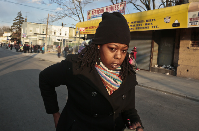 Naquasia LeGrand walks to catch a subway for work on Thursday Feb. 27, 2014 in the Carnarsie section of Brooklyn, N.Y.  A few months ago, LeGrand was just another worker on the line at KFC, boxing ...