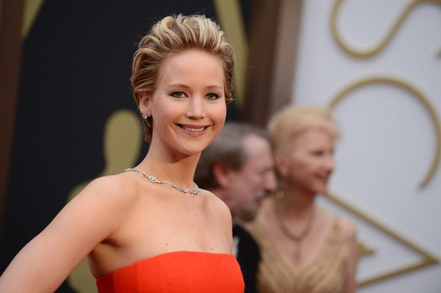Jennifer Lawrence arrives at the Oscars on Sundayat the Dolby Theatre in Los Angeles.  (Photo by Jordan Strauss/Invision/AP)