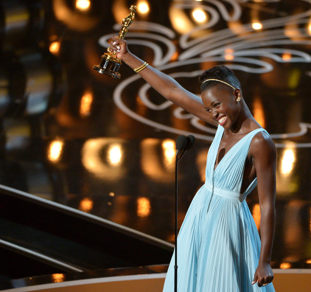 "Lupita Nyongo accepts the award for best actress in a supporting role for ""12 Years a Slave"" during the Oscars on Sunday in Los Angeles. (John Shearer/Invision/AP)"