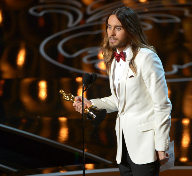 "Jared Leto accepts the award for best actor in a supporting role for ""Dallas Buyers Club"" during the Oscars on Sunday in Los Angeles. (John Shearer/Invision/AP)"