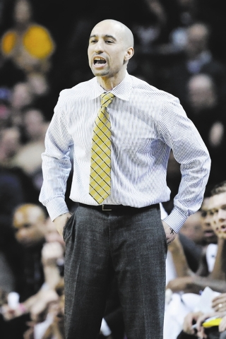 VCU head coach Shaka Smart directs his players from the bench during the first half of an NCAA college basketball game against Richmond in the quarterfinal round of the Atlantic 10 Conference tour ...